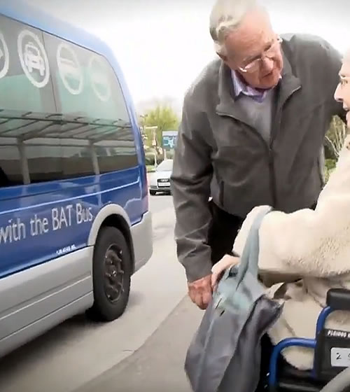A passenger using the wheelchair-accessiblehospital hop
